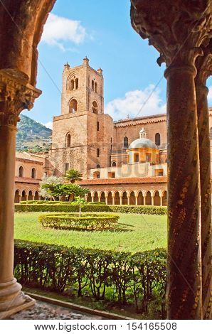 MONREALE ITALY - OCTOBER 10 2016: The French ornamental garden of Monreale Cloister surrounded by Arabic arcade with masterpiece columns decorated with carvings mosaic and inlay on October 10 in Monreale.