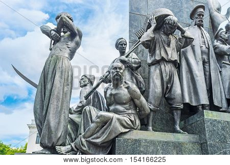 KHARKOV UKRAINE - MAY 20 2016: The statues of Ukrainian peasants -serfs around the monument to the famous poet writer and freedom fighter - Taras Shevchenko who was the serf by himself  on May 20 in Kharkov.