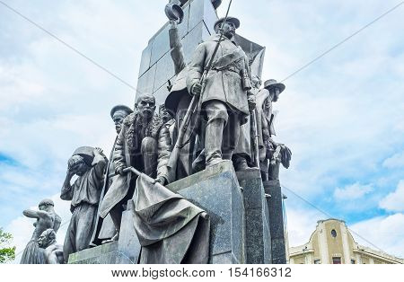 KHARKOV UKRAINE - MAY 20 2016: The statues of participants of the Russian Revolution at the Taras Shevchenko Monument on May 20 in Kharkov.