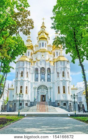 The Church of the Holy Myrrh-Bearers through the shady trees in Victory Square Kharkov Ukraine.