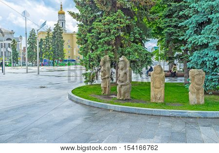 KHARKOV UKRAINE - MAY 20 2016: The stone idols of the ancient Slavs and Scythians decorate the flowerbed and attract people to visit State Historical Museum on May 20 in Kharkov.