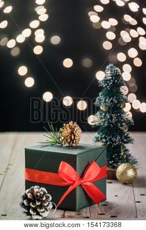 christmas decorations and green present on wood.