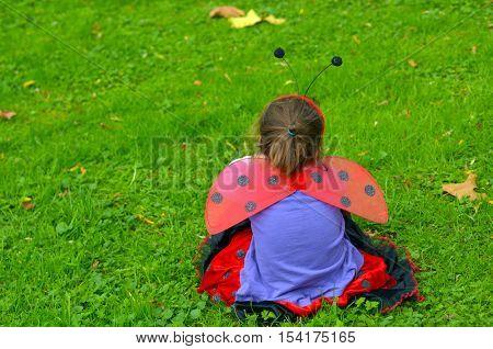 Sad Little Girl Age 05 Dressed Up As Lady Bug