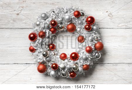 Christmas Wreath Wood Background Hanging Decoration Balls on Holiday Wooden Planks Wall