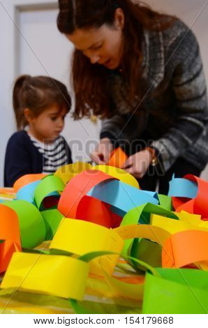 Mother And Child Preparing A Handcraft Decoration Together