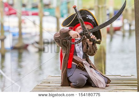 young happy child dressed as a pirate