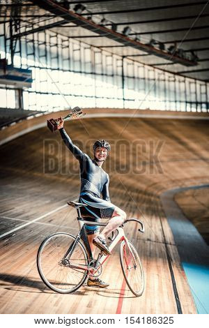 Happy sportsman on a cycle track