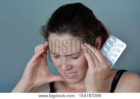 Woman Having Headache Taking Pills