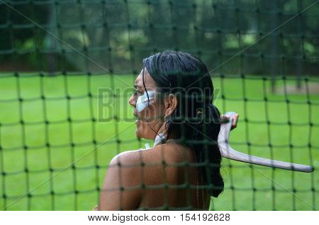 Yirrganydji Aboriginal woman throw boomerang during cultural show in Queensland Australia.