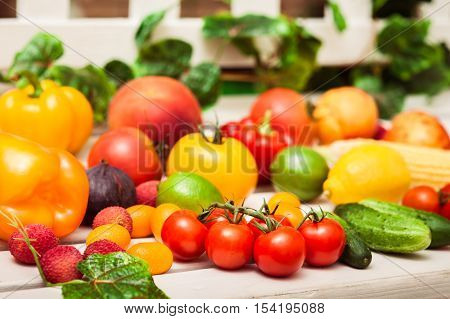 Variety Of Fruits And Vegetables Scattered On The White Bench En