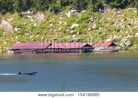 Image of raft floating on the water and long tail boat in thailand