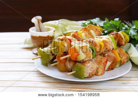 chicken kebab with onions and bell peppers