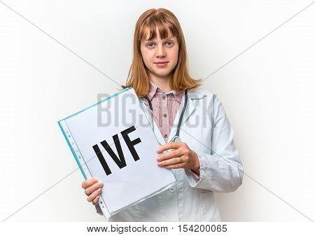Female Doctor Showing Clipboard With Written Text: Ivf