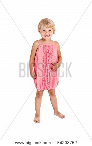 Pretty girl posing for the camera in a pink short dress isolated on white background