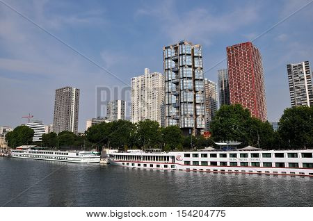 PARIS FRANCE - JULY2: The Novotel Paris Tour Eiffel hotel and boat hotel on July 2 2015 in Paris France. Novotel is a modern hotel located in Beaugrenelle area in the 15th arrondissement of Paris overlooking the Seine river.