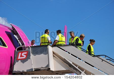 KATOWICE - JULY 2: Cabin crew staff leaving the Wizzair Airbus A320 after the landing on July 2 2015 in Katowice Airport Poland. Wizzair is one of the largest low-cost airlines.