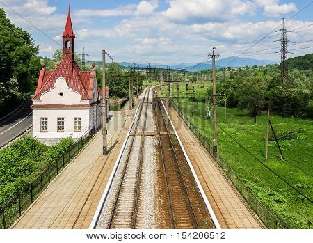 Karpaty railway station - a train stop point near the famous Schönborn Castle former residence and hunting lodge of Count Schönborn and since 1946 - sanatorium