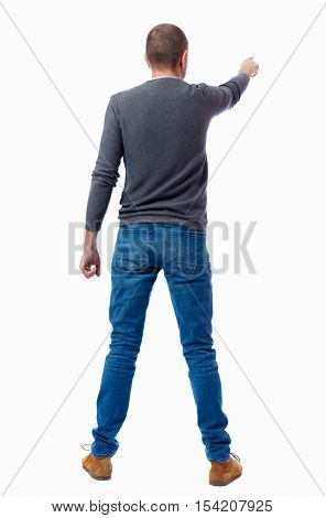 Back view of pointing business man. Rear view people collection.  backside view of person.  Isolated over white background. A guy in a gray sweater shows his hand to the side.