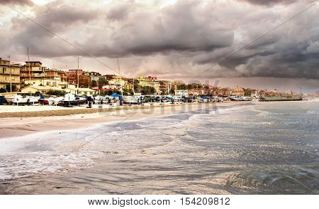 Beautiful landscape of the coast with dramatic sky and choppy sea. Falconara Italy.