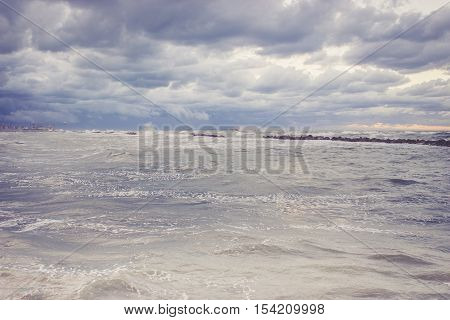 Beautiful landscape with dramatic sky above the choppy sea in the evening