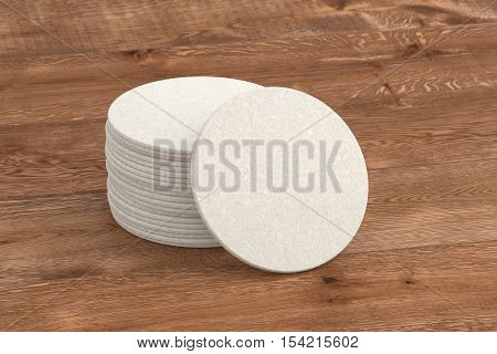 Beer coasters. Isolated on wood background. Include clipping path. 3d render