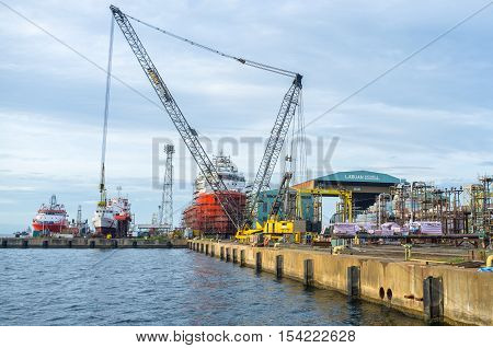 Labuan,Malaysia-June 15,2013:Various vessels under repairing in Labuan shipyard dock.Its a Malaysian shipbuilding company based in the East Malaysian island of Labuan & the biggest shipyard in Borneo