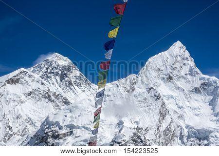 Beautiful Landscape of  Everest and Lhotse peak with colorful Nepali flag from Kala Pattar view point. Gorak Shep. During the way to Everest base camp. Sagarmatha national park. Nepal.
