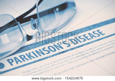 Parkinsons Disease - Printed Diagnosis with Blurred Text on Blue Background with Eyeglasses. Medical Concept. 3D Rendering.