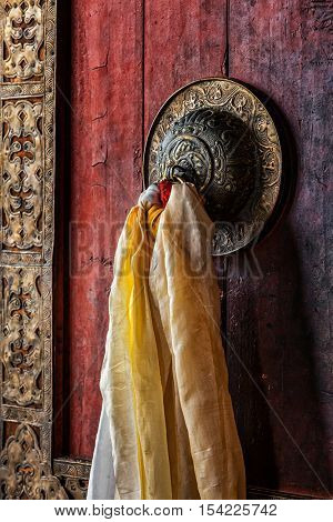 Decorated door handle of gates of Thiksey gompa (Tibetan Buddhist monastery). Ladakh, India