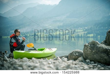 Recreational Lake Kayaking. Young Caucasian Sportsman at the Lake with His Kayak.