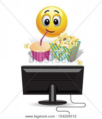 Smiley ball enjoying watching a movie at home. Smiley ball watching a movie on tv and eating  popcorn.