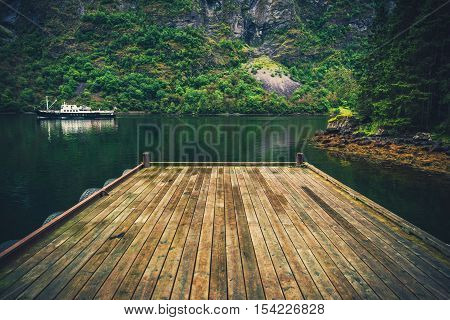 Scenic Wooden Fjord Deck and Local Ferry Boat in Norway. Norwegian Landscape.