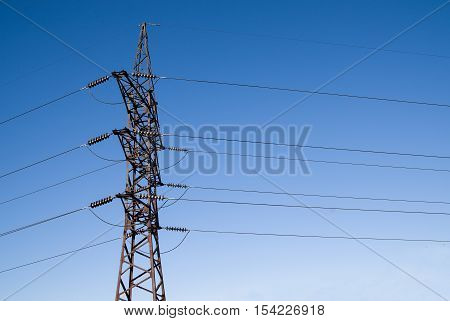 Tower of power-supply system on the background of blue sky