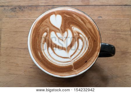 Hot cup of latte art coffee stock photo