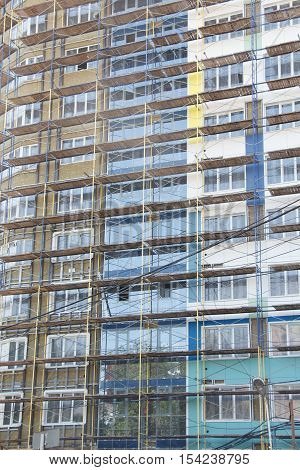 New incomplete residential building facade in scaffolding