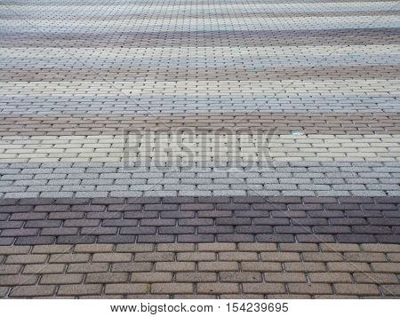 Gradient grey and brown brick floor for background and texture