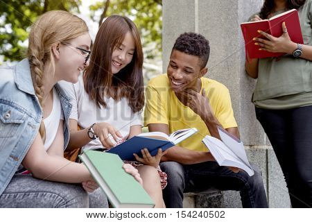 Young Diverse Group Studying Outdoors Concept