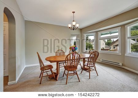 Beige Dining Room Interior With Round Wall