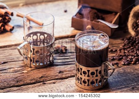 Coffee time in a cozy cottage on old wooden table