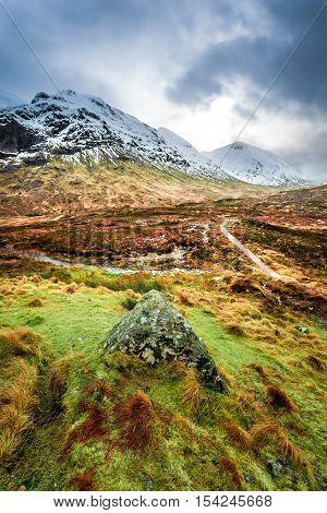 Footpath in Glencoe mountains in winter, Scotland