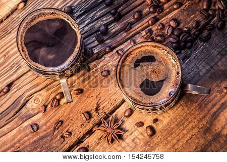 Closeup Of Hot Coffee In Old Wooden Table