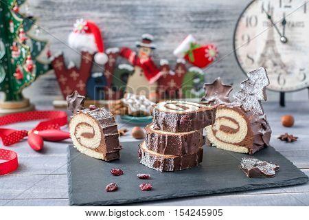 Cakes Bush de Noel Christmas Log on New Year background