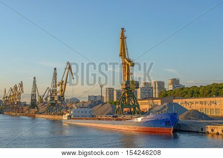 Bulk ship under loading in port terminal