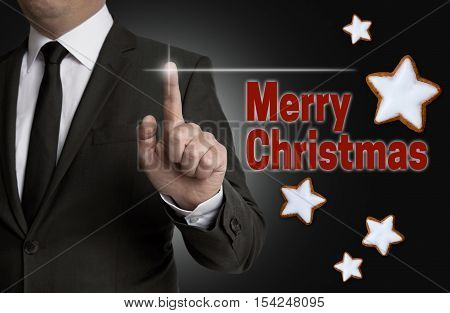 Merry Christmas touchscreen is operated by a businessman.