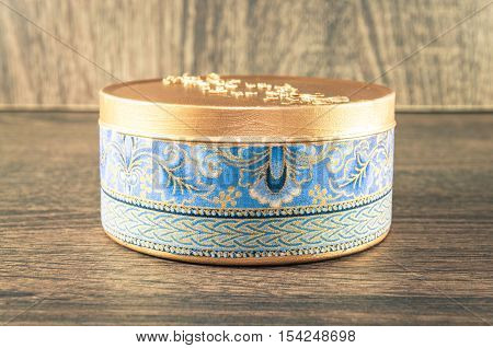 Handmade Candle Made In The Golden Rounded Box Decorated With Textured Fabric. Scenery And Wooden Ba