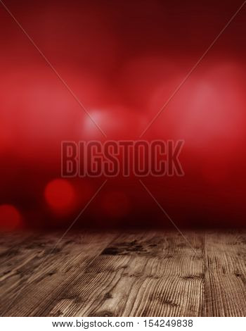 Dark red valentine day background with an empty wooden table for a concept