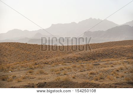 Desert and layers of mountain majestic landscape in Iran
