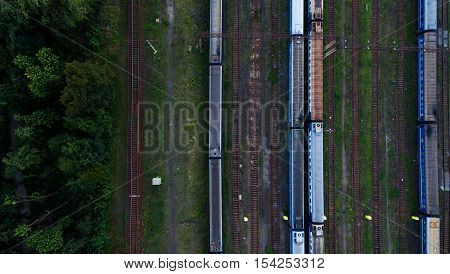 Aerial view of railroad station. Trains and Carriages in a sump.