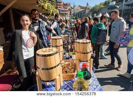 TBILISI, GEORGIA - OCT 16, 2016: Crowd of people walking around showcase of the private wine company at the Tbilisoba on October 16, 2016. Tbilisoba is traditional festival in capital of Georgia from 1979