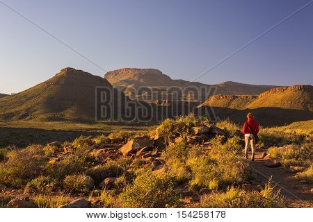 Tourist Walking On Marked Trail In The Karoo National Park, South Africa. Scenic Table Mountains, Ca